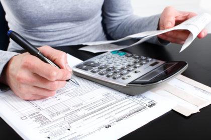 bigstock-Filling-The-Tax-Form-6902119